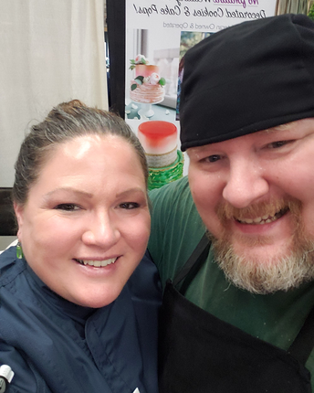 dual veteran husband and wife bakery team at wedding show